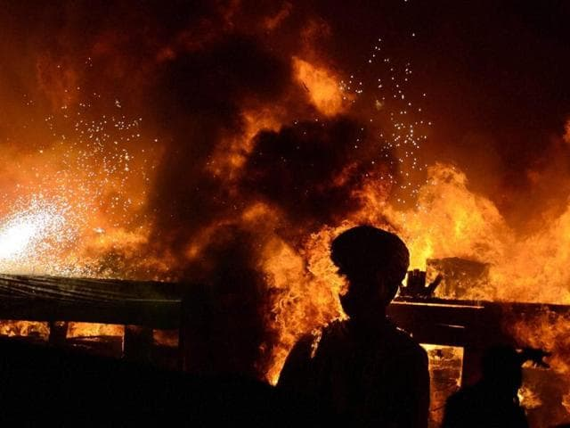 The Stage goes up in flames on Maharashtra Night at Girgaum Chowpatty in Mumbai, India, on Sunday, February 14, 2016.