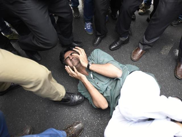 Teachers and students of the Jawaharlal Nehru University or JNU and journalists were attacked and threatened at a Delhi court today as dozens of policemen watched.