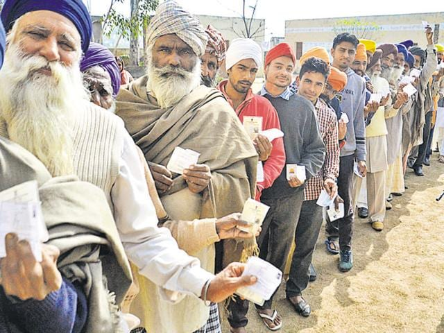 Voters at a polling station during the Khadoor Sahib bypoll at Rani Wala village on Saturday.