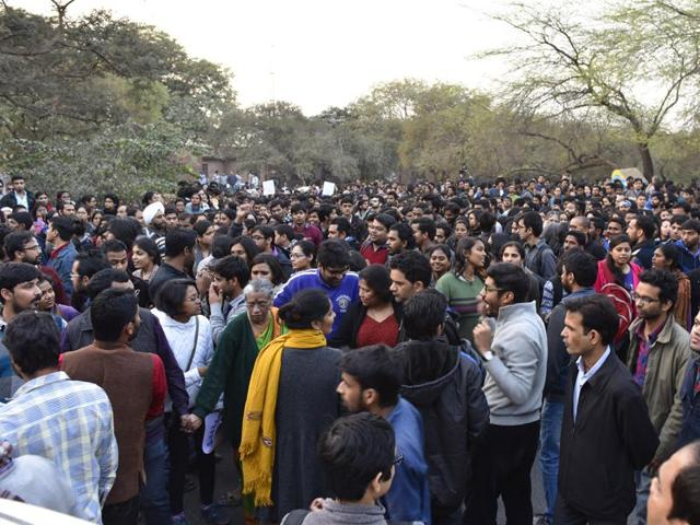 JNU teachers and students form a human chain inside the campus in protest against arrest of JNUSU President Kanhaiya at JNU campus in New Delhi.