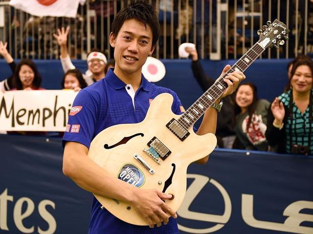 Taylor Fritz of the US, left, congratulates Kei Nishikori of Japan after the final of the Memphis Open on February 14, 2016. Nishikori won 6-4, 6-4.