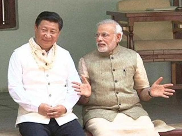 China's President Xi Jinping with Prime Minister Narendra Modi during his visit to Sabarmati Ashram in Ahmedabad.  Chinese state media has said India is manipulating and creatively using economic data against China.