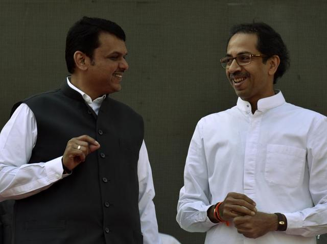 Maharashtra chief minister Devendra Fadnavis (L) with Shiv Sena chief Uddhav Thackeray (R) in Mumbai.