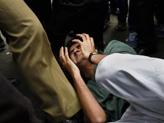A group of lawyers allegedly thrashed protesters and journalists inside the Patiala House court premises on Monday during the hearing on the extension of police custody of JNU students body president Kanhaiya Kumar arrested on charges of sedition.