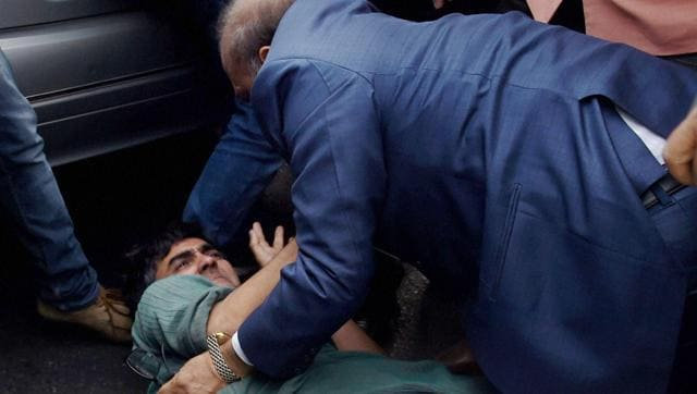 BJP MLA OP Sharma thrashing one of the JNU students who were protesting against the arrest of JNUSU President Kanhaiya Kumar during a clash between the advocates and the students outside the Patiala House Courts in New Delhi on Monday.