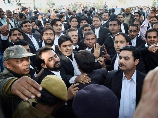 Advocates clash with the JNU students and journalists present at the hearing of JNUSU president Kanhaiya Kumar's case in Patiala House Court in New Delhi on
