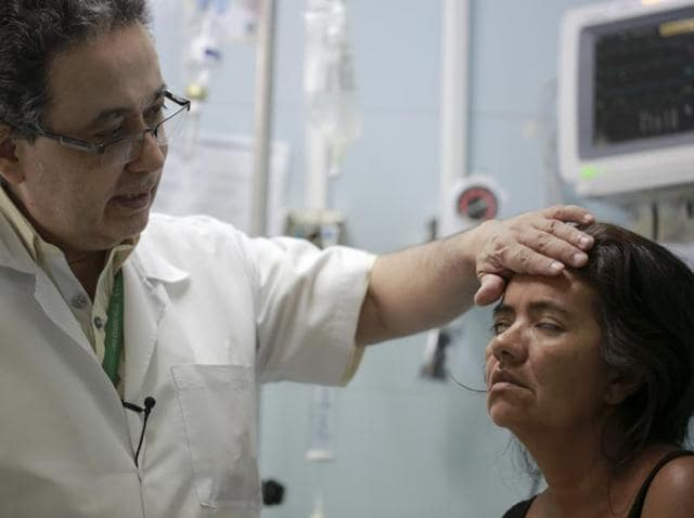 Zulay Balza fails to close her eyes as neurologist Jairo Lizarazo tests her facial muscles at the Erasmo Meoz Hospital in Cucuta, Colombia. Balza was diagnosed with Guillain-Barre Syndrome, a disorder in which the immune system attacks nerve cells, causing muscle weakness and sometimes paralysis.