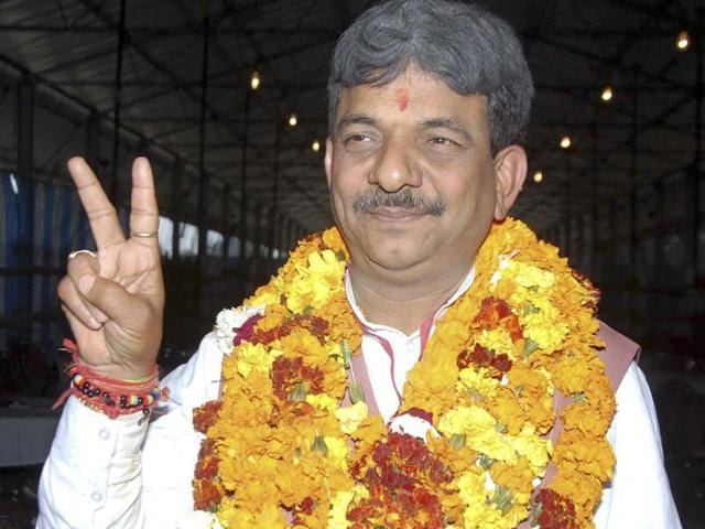 BJP leader Kapil Deo makes the victory sign after winning a by-election for the Muzaffarnagar assembly seat.