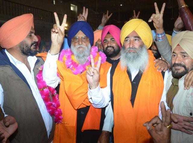 SADcandidate Ravinder Singh Brahmpura  and his father and MP  Ranjeet Singh Brahmpura  showing victory sign after winning the Khadoor Sahib by-elections on Tuesday.