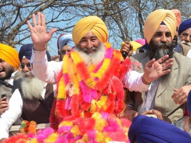 SAD candidate Ravinder Singh Brahmpura celebrates after winning the Khadoor Sahib bypoll on Tuesday.