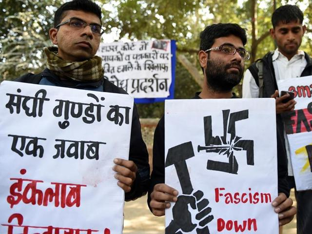 Indian activists of the DISHA Students Organistion hold placards against the February 15, 2016 attack on JNU students and teachers at Patiala House court, during a protest in New Delhi on February 16, 2016.