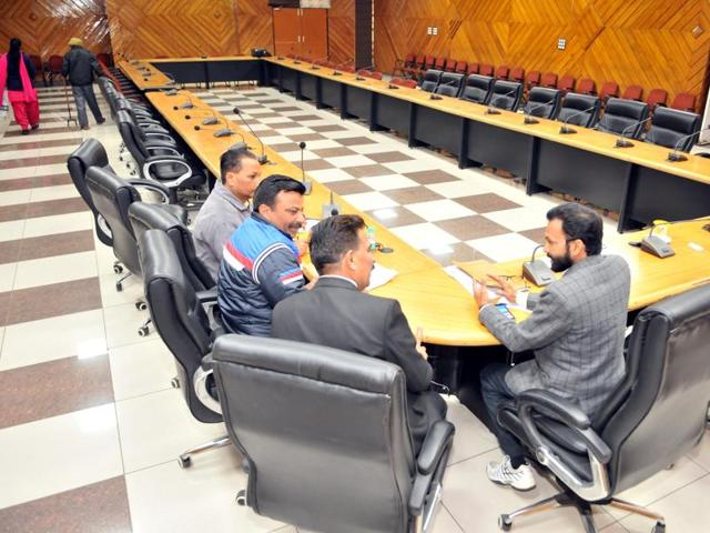 Official of the district administration waiting for the representatives of private schools in a meeting hall in Jalandhar on Monday.