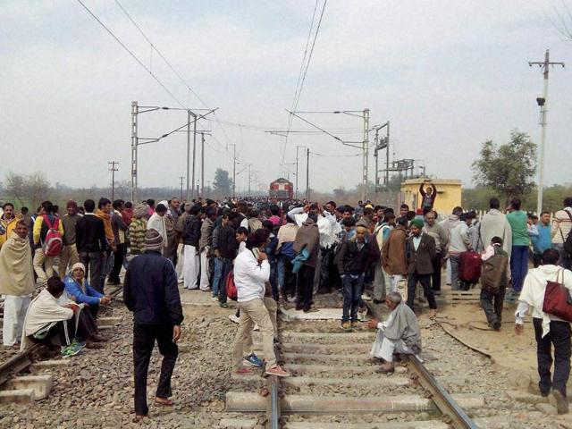 Jat community members block the railway tracks during their agitation for reservation near Rohtak on Monday.
