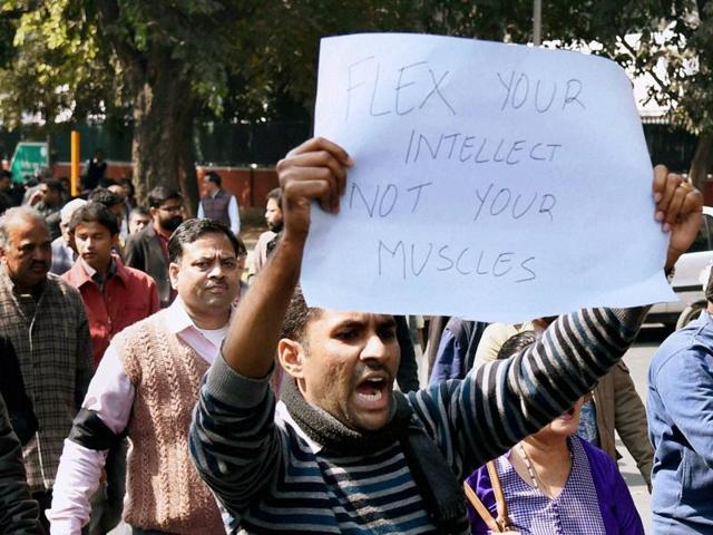 Journalists at a protest march against the Monday's attack on media persons and JNU students by lawyers outside and inside Patiala House court in New Delhi.