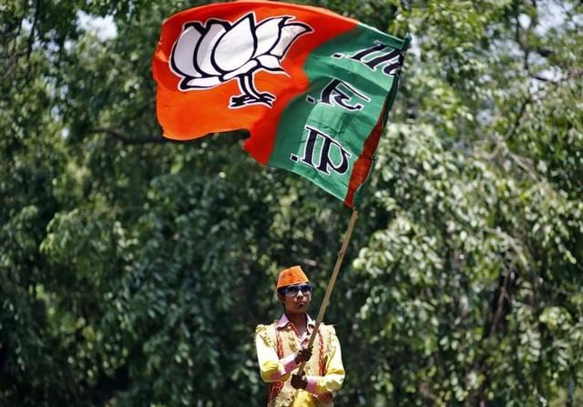 BJP supporters take out a victory procession for winning the Muzaffarnagar seat in the by-elections on Tuesday. After a discouraging performance last year, the BJP will need to play its cards right as it faces elections in four states and one union territory this year. B