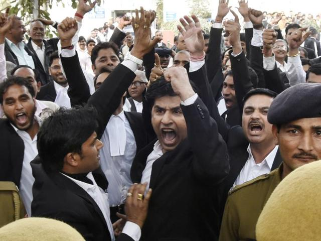 Activists from India's ruling Bharatiya Janata Party (BJP) shout slogans during a protest against the Jawaharlal Nehru University Students Union (JNUSU) in Mumbai on February 15, 2016.