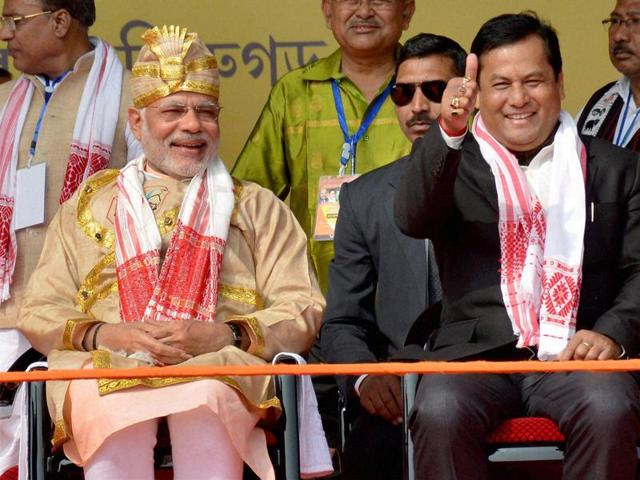 Prime Minister of India Narendra Modi along with Union Minister of State for Sports and Assam BJP President Sarbananda Sonowal at a public rally at Moran.