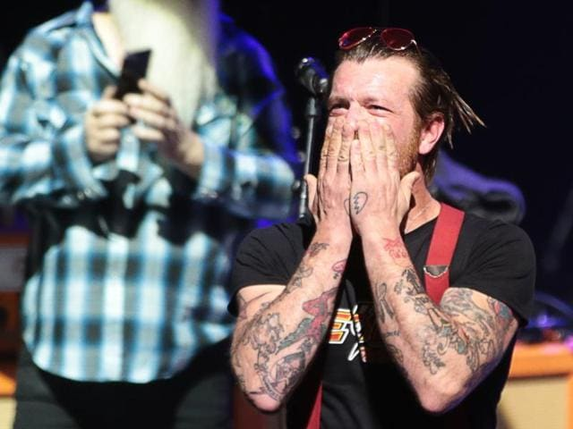 Jesse Hughes of US rock group Eagles of Death Metal, blows a kiss before the start of the concert at the Olympia concert hall in Paris, on February 16, 2016. Eagles of Death Metal, the Californian rock group who were playing at the Bataclan music hall in Paris when jihadist gunmen burst in and killed 90 people in November, returned to the French capital for a concert at the Olympia.
