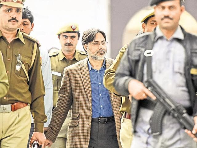 Delhi Police officers with SAR Geelani, the Delhi University lecturer was booked for sedition on early Tuesday morning for allegedly organising the Afzal Guru event at the Press Club of India.