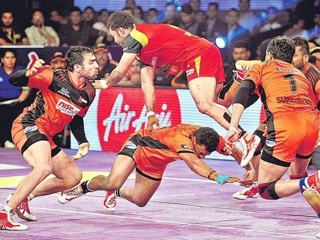 Kabaddi players of U Mumbai (black and orange) and Pink Panthers (pink and blue) in action during the inaugural match of Pro-Kabaddi league in Mumbai.