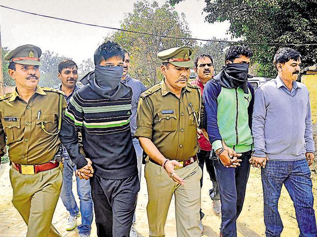 Prime accused Devendra (second from right) has 30 criminal cases pending against him.