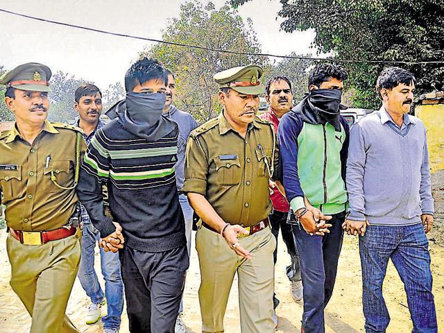 Prime accused Devendra (second from right) and his accomplice in police custody on Tuesday.