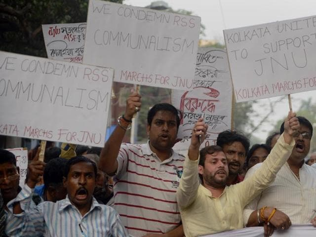 Congress and Leftist activists shout slogans again the ruling Bharatiya Janata Party (BJP) government during a joint protest against the arrest of a student from Jawaharlal Nehru University (JNU) in Kolkata on February 15, 2016.