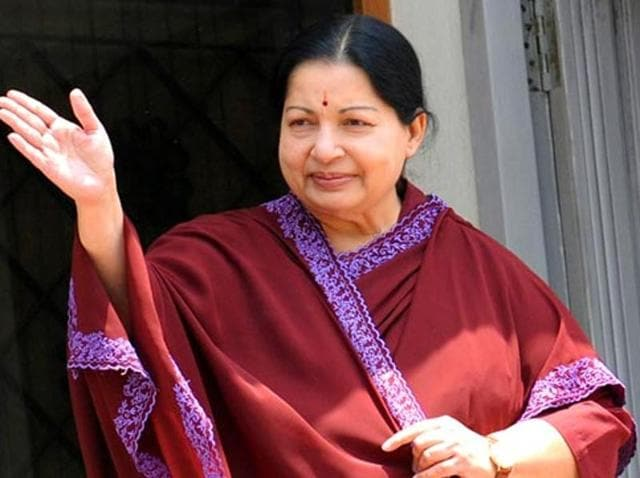 AIADMK leader J Jayalalithaa waves to supporters standing on the balcony of her residence in Chennai.