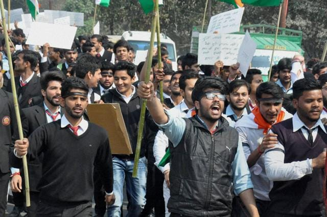 AMU students holding a protest rally over the JNU row, at Aligarh Muslim University in Aligarh on Tuesday.