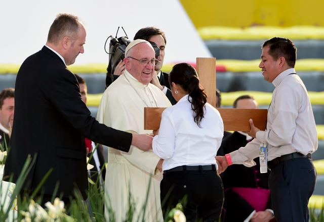 Pope Francis, flanked by Cardinal Alberto Suarez Inda, talks to faithful inside the Cathedral in Morelia , Michoacán.