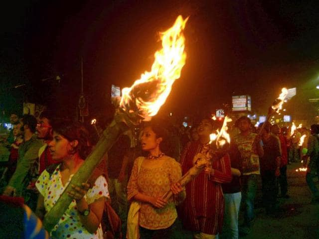 Jadavpur university students take out a torch rally to protest in the wake of the arrest of Jawaharlal Nehru University Student's Union president Kanhaiya Kumar .
