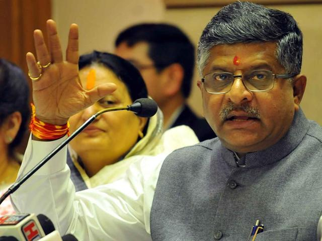 "Union minister for communication and information technology Ravi Shankar Prasad addresses a press conference. He said OP Sharma ""should not have taken law into his own hands and not resorted to violence""."
