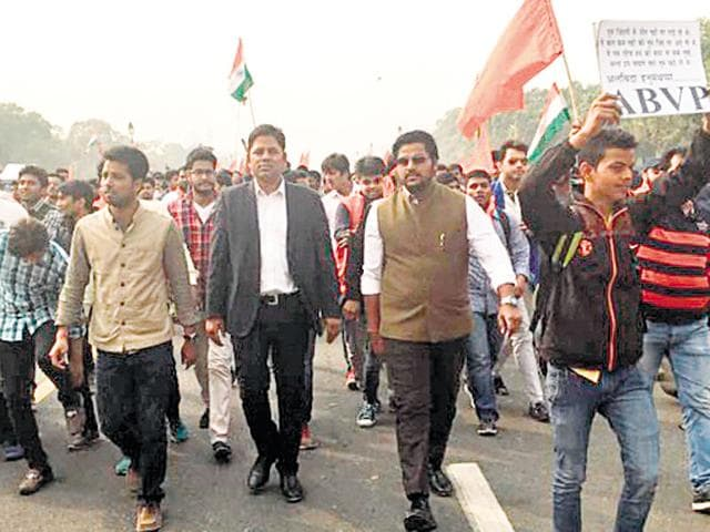 Vikram Chauhan (in black coat) attending a ABVP protest march. He had posted this photo on his Facebook page.