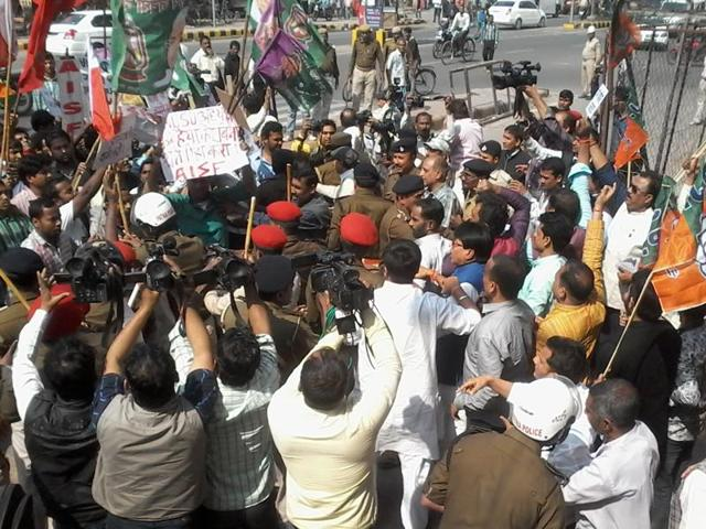 Police break up the clash between protesters and BJP workers outside the party office in Patna on Thursday.