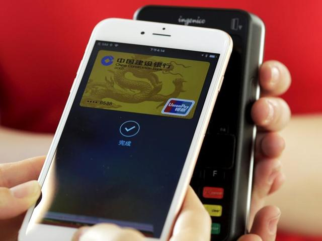 The Apple iPhone and Apple Watch can be used to make payments using the Apple Pay service. China launched the service on Thursday.