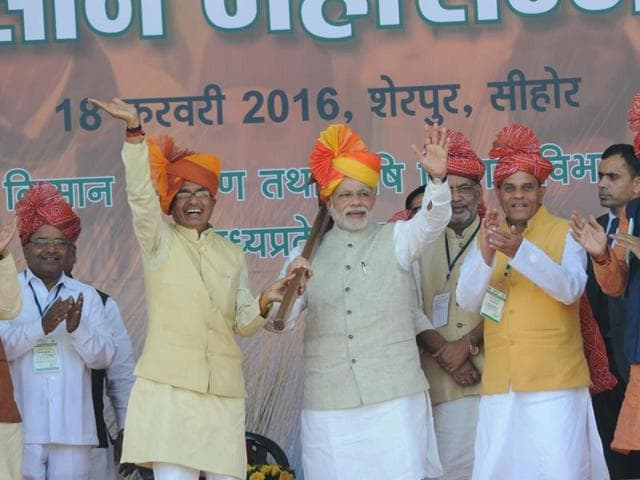 Prime Minister Narendra Modi and chief minister Shivraj Singh Chouhan during the farmers' convention at Sherpur in Sehore on Thursday.