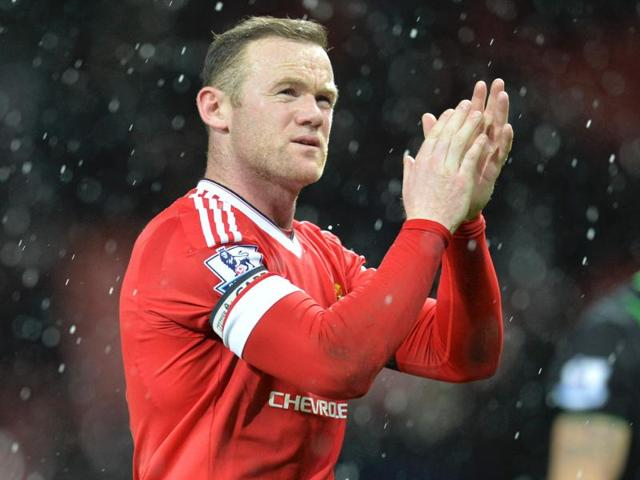 Manchester United's English striker Wayne Rooney applauds at the end of the match against Stoke City.