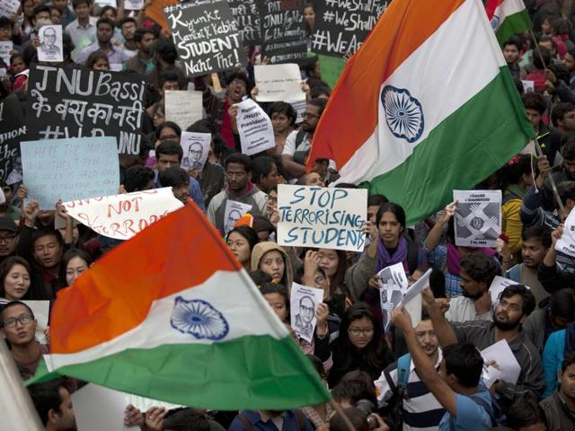 Students wave an Indian flag and shout slogans during a protest at the Jawaharlal Nehru University.