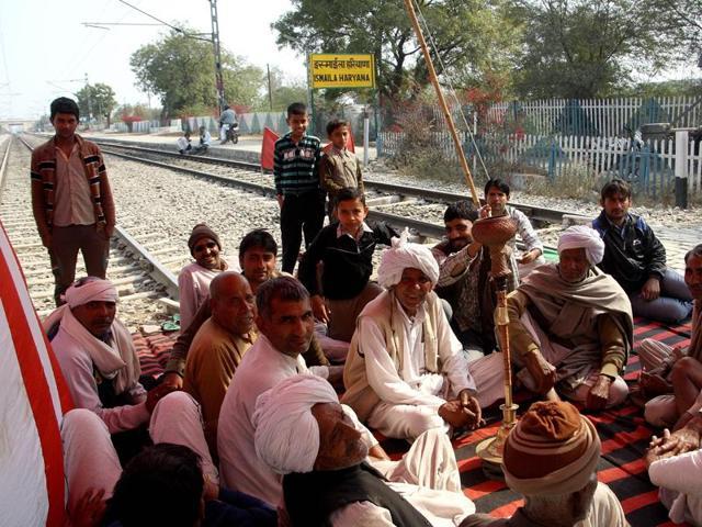Jat protestors blocking Delhi- Rohtak railway track on Wednesday.