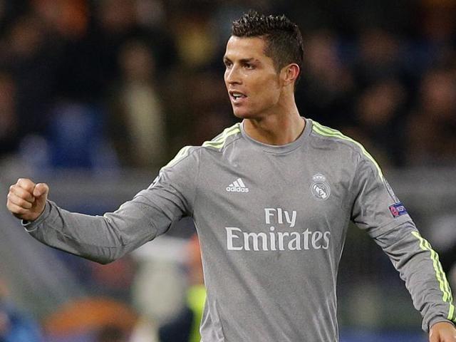 Real Madrid's Cristiano Ronaldo celebrates with teammate Sergio Ramos after scoring against ASRoma.