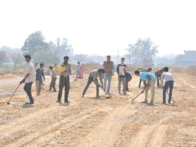 Work on the road at Surya Enclave Extension in progress in Jalandhar on Wednesday.