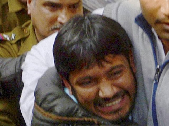Kanhaiya Kumar (C), head of the student union at Delhi's Jawaharlal Nehru University (JNU), is escorted by police outside the Patiala House court in New Delhi