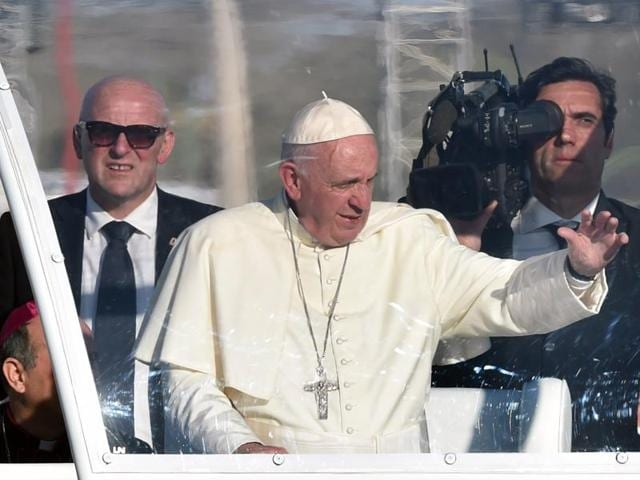 Pope Francis waves as he arrives on the popemobile to celebrate mass at the Ciudad Juarez fairgrounds in Chihuahua state, Mexico on February 17, 2016.
