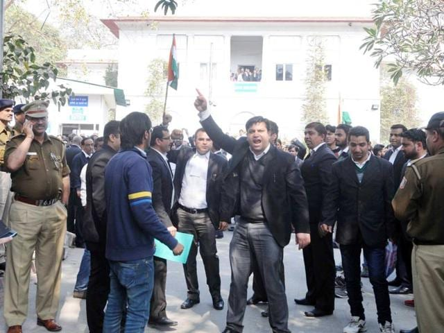 JNU ISSUE_New Delhi, India - Feb. 17, 2016: Lawyers assaulting a journalist outside Patiala House Court on Wednesday. The Bar Council of India has promised to suspend those lawyers found guilty of inciting violence during the clash.