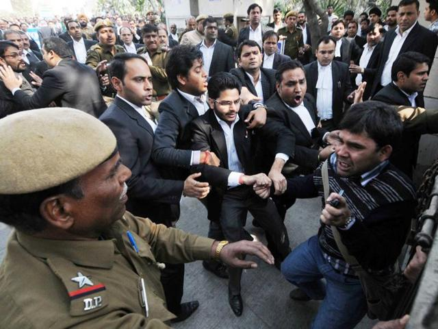 Lawyers assaulting a journalist outside Patiala House Court in New Delhi, India, on Wednesday, February 17, 2016.