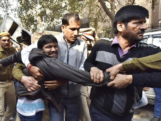 JNU Students Union president Kanhaiya Kumar being taken to Patiala House Court in New Delhi on Wednesday.(Virender Singh Gosain/HT)