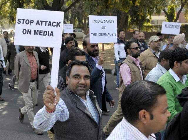 Journalists taking part in a protest march in Chandigarh on Wednesday.