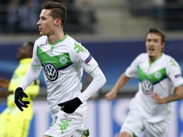 VfL Wolfsburg's Julian Draxler celebrates after scoring against KAA Gent.