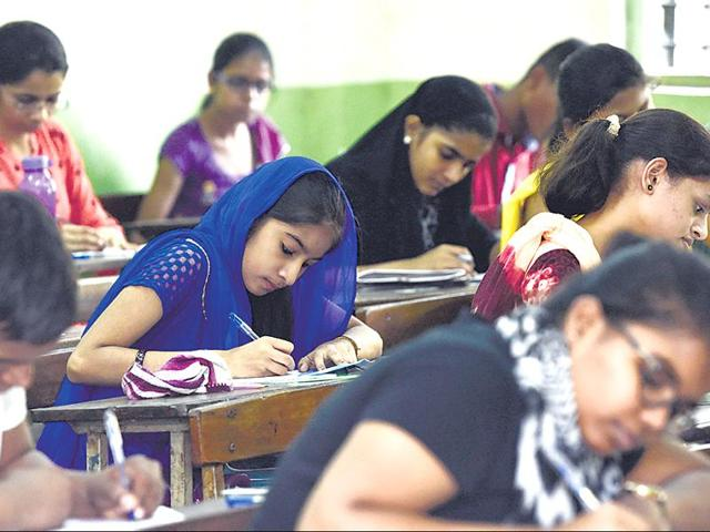 Students at Shivaji Sikshan Santha Multipurpose Technical High School, Ghatkopar (E), get cracking on the English paper, which followed a new activity-based pattern.