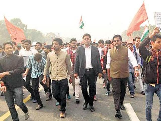 Vikram Chauhan (C, in black coat) attending an AVBP rally. A group of lawyers on Thursday felicitated Chauhan, the lawyer who led the protest at Patiala House court on both Monday and Wednesday. He also allegedly led a mob that targeted JNU students' union leader Kanhaiya Kumar in the court premises.